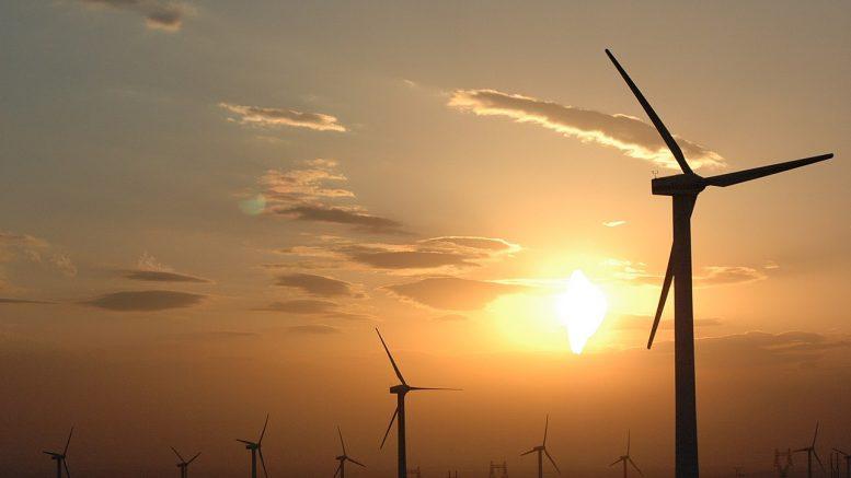 1280px-Wind_power_plants_in_Xinjiang,_China credit wikimedia